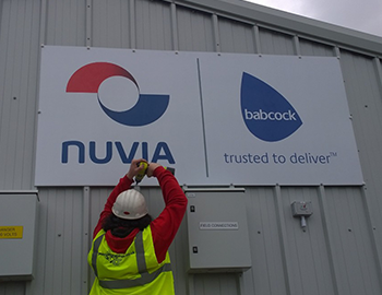 Nuvia sign fitted to outbuilding