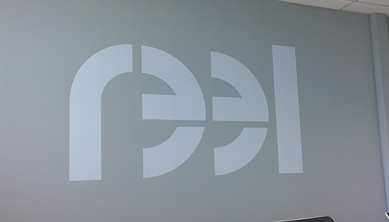 Boardroom wall graphic for Reel Warrington